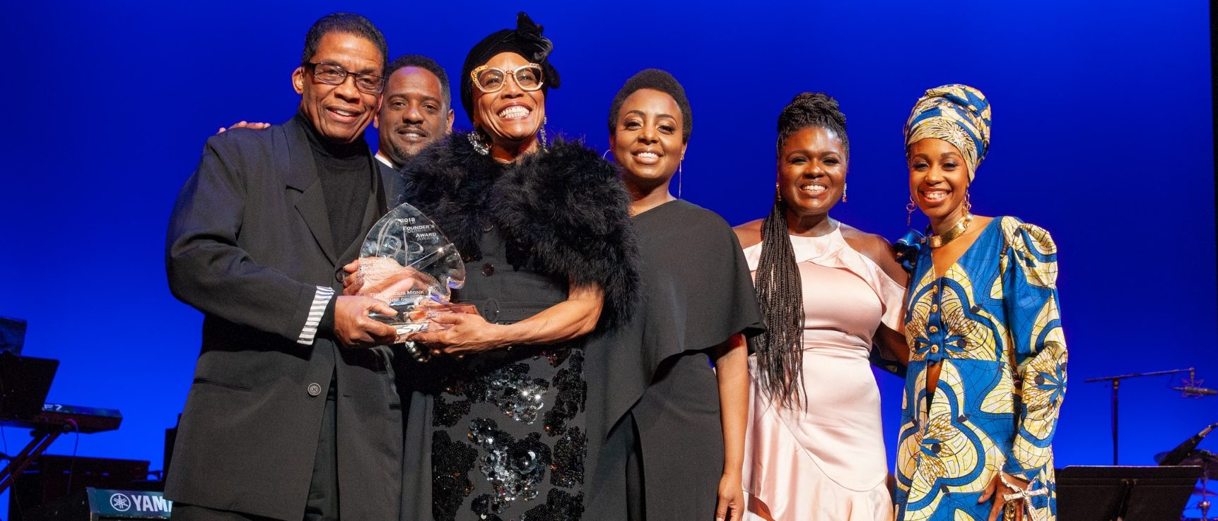 Institute Advisory Board member Dee Dee Bridgewater accepts the 2018 Maria Fisher Founder's Award with (from left) Herbie Hancock, Blair Underwood, Ledisi, Deborah Joy Winans and Jazzmeia Horn.